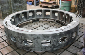 Cleaned and prepped hydro generator stator housing without laminations