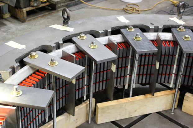 Compressing the stator core laminations